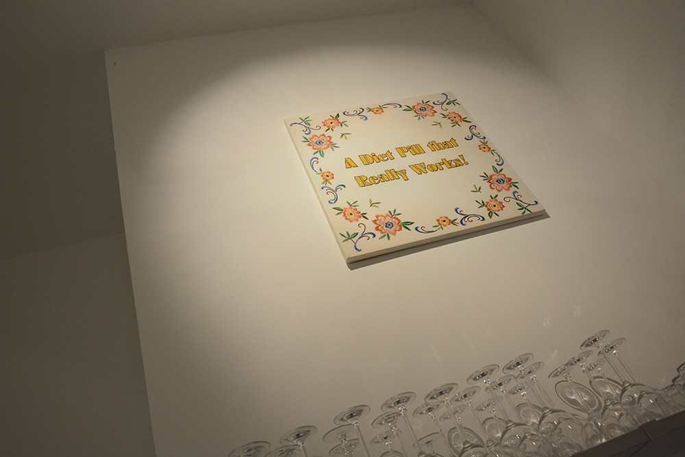 Katharina Arndt // A Diet Pill that Really Works,  2008, Stickerei auf Leinwand, auf Keilrahmen, 65x65cm